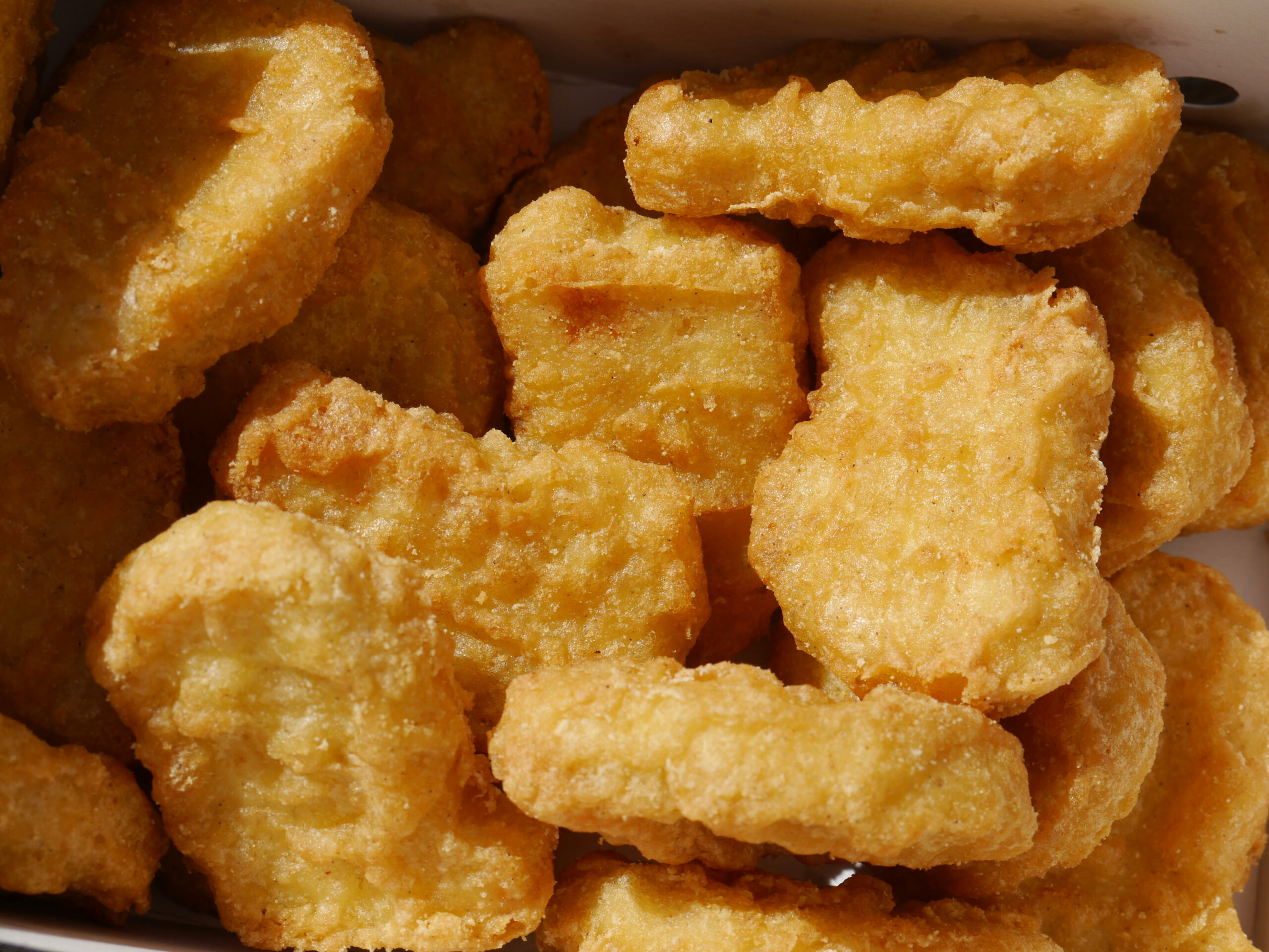 how are chicken McNuggets made